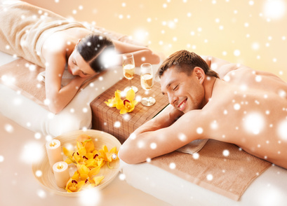 health and beauty, honeymoon and vacation concept - couple in spa salon lying on the massage desks